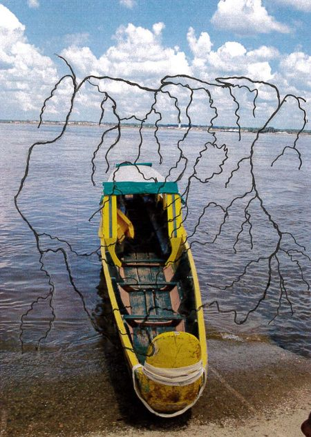 Hand-drawn map of the rivers of Suriname overlaid on a photograph of a korjaal docked on the bank of the River Marowijne (which forms the border between Suriname and French Guiana). Sean Leonard, 2020.